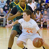 "Five foot five inch guard from Rockville, Michael Mantzouranis shows no fear dribbling the basketball around 6' 1"" Seneca Valley guard Kareem Matthew."
