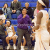 Coach McDaniel offers encounragement from the team bench to his Lady Trojans of Gaoithersburg.