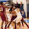 In another battle for posession of the ball in th elane, Gaithersburg's Jeweles Pritchett (23) puts some muscle into the mixup.
