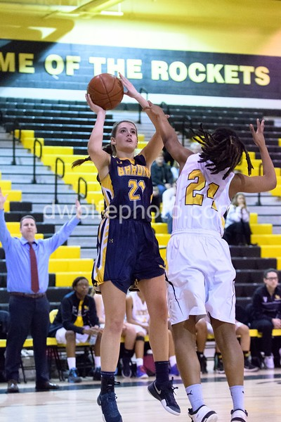 Bethesda Chevy Chase's Caitlyn Clendenin gets off a two pointer despite the heavy handed coverage by Nusaibah Rashad of Richard Montgomery.