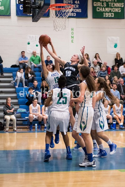 Whitman junior Abby Meyers steals a rebound from Churchill's Captain Nina Hazra.
