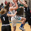 Olivia Myers of Whitman blocks a layup attempt by Coco Kuchins a captain on the Winston Churchill girls basketball team.