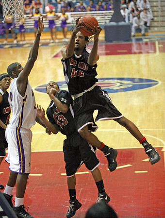 Druid Hills #42 Jarrad Riley with a slam dunk over teammate #23 Don Rogers and Villa Rica #34 Omar McLendon