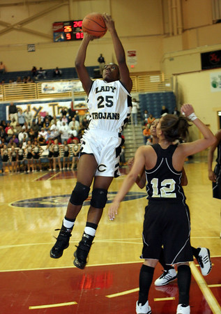 Lady Trojan's #25 Brittany Wiley makes a shot over East Hall's #12 Leania Bullock