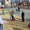 Albert Ortiz one of the coaches for the Central MA Warriors, a new AAU basketball team, watches over the kids at the Green Street Park on April 1st. SENTINEL & ENTERPRISE/JOHN LOVE