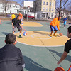 Players on the Central MA Warriors, a new AAU basketball team, Alex Morrison, 14, and Savon Hughes, 15, work with some younger kids to teach them some dribbling drills at the Green Street Park on May 1st. SENTINEL & ENTERPRISE/JOHN LOVE