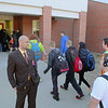 Ishmael Tabales one of the coaches for the Central MA Warriors, a new AAU basketball team, and the principal of the Ralph C. Mahar Regional School in Orange MA watches over the students as they  arrive at the school Friday morning. SENTINEL & ENTERPRISE/JOHN LOVE