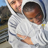 Albert Ortiz one of the coaches for the Central MA Warriors, a new AAU basketball team, hugs one of his players Isaiah Moses, 14, after he told him he got A's in his classes as they hung out at the Green Street Park on Wednesday afternoon. SENTINEL & ENTERPRISE/JOHN LOVE