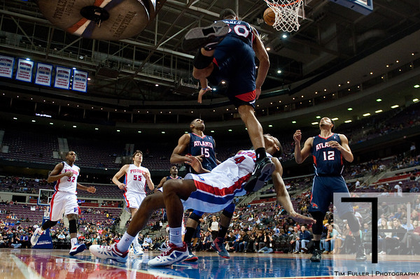 Feb 25, 2013; Auburn Hills, MI, USA; Detroit Pistons shooting guard Kim English (24) collides with Atlanta Hawks small forward Dahntay Jones (30) during the fourth quarter at The Palace. Atlanta won 114-103. Mandatory Credit: Tim Fuller-USA TODAY Sports