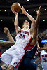 Feb 25, 2013; Auburn Hills, MI, USA; Detroit Pistons shooting guard Kyle Singler (25) goes to the basket against the Atlanta Hawks during the third quarter at The Palace. Atlanta won 114-103. Mandatory Credit: Tim Fuller-USA TODAY Sports