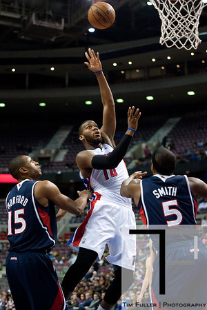 Feb 25, 2013; Auburn Hills, MI, USA; Detroit Pistons center Greg Monroe (10) shoots over Atlanta Hawks center Al Horford (15) and small forward Josh Smith (5) during the third quarter at The Palace. Atlanta won 114-103. Mandatory Credit: Tim Fuller-USA TODAY Sports