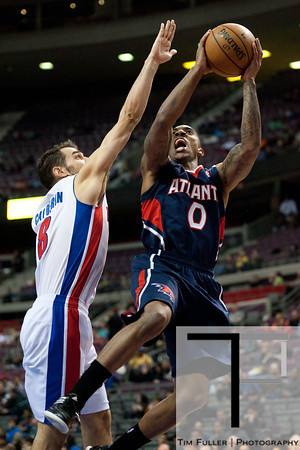 Feb 25, 2013; Auburn Hills, MI, USA; Atlanta Hawks point guard Jeff Teague (0) goes to the basket against Detroit Pistons point guard Jose Calderon (8) during the second quarter at The Palace. Mandatory Credit: Tim Fuller-USA TODAY Sports