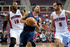 Feb 25, 2013; Auburn Hills, MI, USA; Atlanta Hawks point guard Devin Harris (34) gets past Detroit Pistons center Greg Monroe (10) and point guard Jose Calderon (8) during the first quarter at The Palace. Mandatory Credit: Tim Fuller-USA TODAY Sports