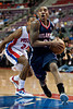 Feb 25, 2013; Auburn Hills, MI, USA; Atlanta Hawks point guard Jeff Teague (0) gets past Detroit Pistons shooting guard Kim English (24) during the second quarter at The Palace. Mandatory Credit: Tim Fuller-USA TODAY Sports