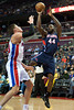 Feb 25, 2013; Auburn Hills, MI, USA; Atlanta Hawks power forward Ivan Johnson (44) shoots over Detroit Pistons power forward Jonas Jerebko (33) during the second quarter at The Palace. Mandatory Credit: Tim Fuller-USA TODAY Sports