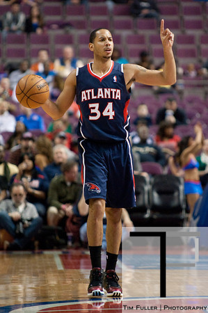 Feb 25, 2013; Auburn Hills, MI, USA; Atlanta Hawks point guard Devin Harris (34) brings the ball up court against the Detroit Pistons during the second quarter at The Palace. Mandatory Credit: Tim Fuller-USA TODAY Sports