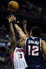Oct 26, 2012; Auburn Hills, MI, USA; Atlanta Hawks shooting guard John Jenkins (12) attempts to block Detroit Pistons point guard Rodney Stuckey (3) during the fourth quarter at The Palace. Detroit won 104-88. Mandatory Credit: Tim Fuller-US PRESSWIRE