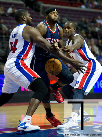 Oct 26, 2012; Auburn Hills, MI, USA; Atlanta Hawks small forward Josh Smith (5) loses the ball while being pressured by Detroit Pistons power forward Jason Maxiell (54) and point guard Rodney Stuckey (3) during the first quarter at The Palace. Mandatory Credit: Tim Fuller-US PRESSWIRE
