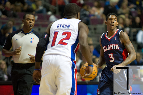 Oct 26, 2012; Auburn Hills, MI, USA; Atlanta Hawks shooting guard Louis Williams (3) brings the ball up court against Detroit Pistons point guard Will Bynum (12) during the game at The Palace. Mandatory Credit: Tim Fuller-US PRESSWIRE