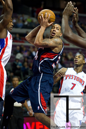 Oct 26, 2012; Auburn Hills, MI, USA; Atlanta Hawks point guard Devin Harris (34) drives to the basket against Detroit Pistons defenders during the first quarter at The Palace. Mandatory Credit: Tim Fuller-US PRESSWIRE