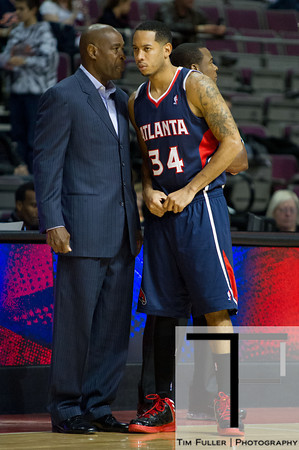 Oct 26, 2012; Auburn Hills, MI, USA; Atlanta Hawks head coach Larry Drew talks to point guard Devin Harris (34) during the first quarter against the Detroit Pistons at The Palace. Mandatory Credit: Tim Fuller-US PRESSWIRE