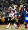 Oct 26, 2012; Auburn Hills, MI, USA; Detroit Pistons center Greg Monroe (10) drives past Atlanta Hawks power forward Al Horford (15) during the third quarter at The Palace. Detroit won 104-88. Mandatory Credit: Tim Fuller-US PRESSWIRE