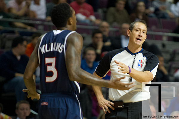 Oct 26, 2012; Auburn Hills, MI, USA; Atlanta Hawks shooting guard Louis Williams (3) talks to NBA referee J.T. Orr (72) during the game against the Detroit Pistons at The Palace. Detroit won 104-88. Mandatory Credit: Tim Fuller-US PRESSWIRE