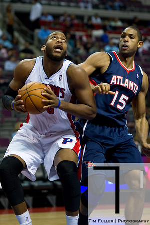 Oct 26, 2012; Auburn Hills, MI, USA; Detroit Pistons center Greg Monroe (10) drives to the basket against Atlanta Hawks power forward Al Horford (15) during the third quarter at The Palace. Detroit won 104-88. Mandatory Credit: Tim Fuller-US PRESSWIRE