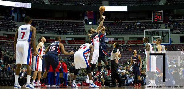 Oct 26, 2012; Auburn Hills, MI, USA; Detroit Pistons center Greg Monroe (10) and Atlanta Hawks small forward Josh Smith (5) jump for the jump ball at the beginning of the game at The Palace. Mandatory Credit: Tim Fuller-US PRESSWIRE