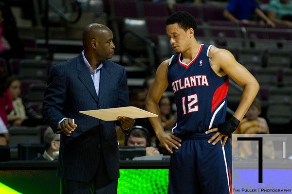 Oct 26, 2012; Auburn Hills, MI, USA; Atlanta Hawks head coach Larry Drew talks with shooting guard John Jenkins (12) during the game at The Palace. Detroit won 104-88. Mandatory Credit: Tim Fuller-US PRESSWIRE