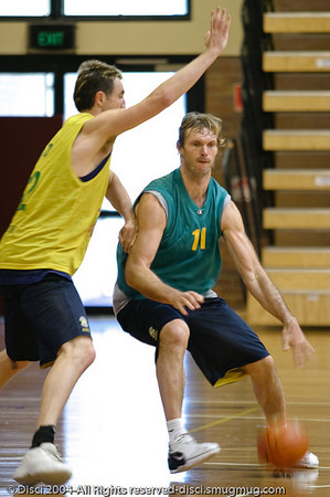 """The Bear"" Tony Ronaldson takes on Paul Rogers in the low post - Boomers' Basketball - Public Pre-Olympic  Training Session, 29 May 2004; Gold Coast, Queensland, Australia."