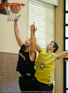 David Stiff beats Mattie Nielsen to the hoop - Boomers' Basketball - Public Pre-Olympic  Training Session, 29 May 2004; Gold Coast, Queensland, Australia.
