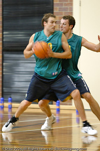 """Two Athletes go at it."" - Jason Smith takes on Glenn Saville in the low post - Boomers' Basketball - Public Pre-Olympic  Training Session, 29 May 2004; Gold Coast, Queensland, Australia."