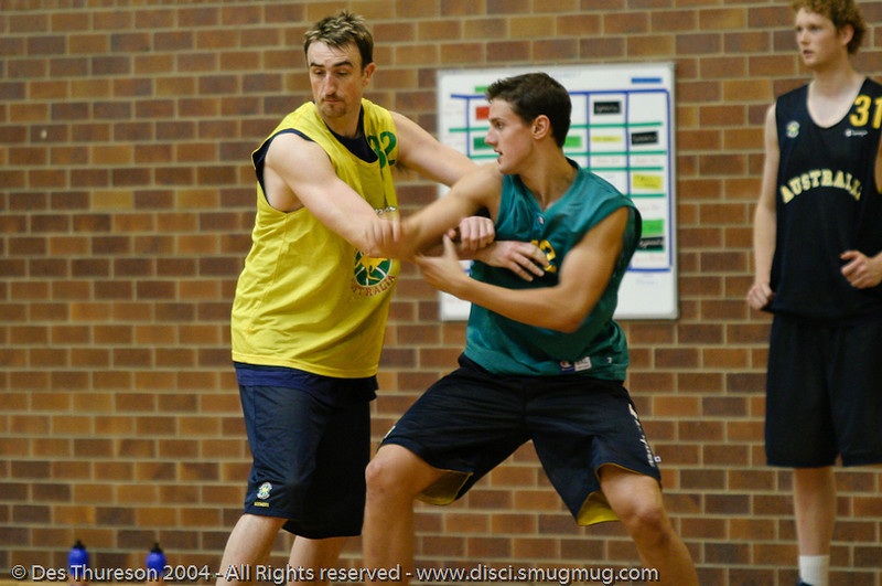 Paul Rogers & Daniel Kickert compete close to the basket - Boomers' Basketball - Public Pre-Olympic  Training Session, 29 May 2004; Gold Coast, Queensland, Australia.