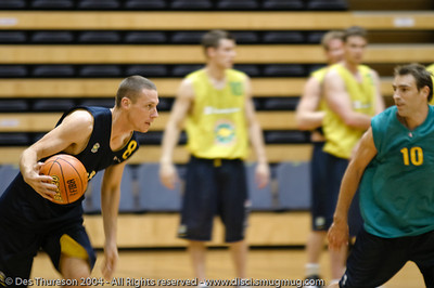 Shooting Guard John Dillie advances the ball while watched by fellow shooting guard Jason Smith - Boomers' Basketball - Public Pre-Olympic  Training Session, 29 May 2004; Gold Coast, Queensland, Australia.