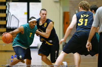 John Rillie (8) tries to not become detached from point guard CJ Bruton (7) - Boomers' Basketball - Public Pre-Olympic  Training Session, 29 May 2004; Gold Coast, Queensland, Australia.
