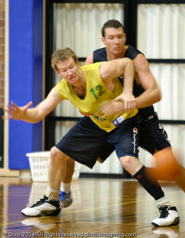 Mattie Campbell (12) competes with Sydney Olympian Martin Cattalini - Boomers' Basketball - Public Pre-Olympic  Training Session, 29 May 2004; Gold Coast, Queensland, Australia.