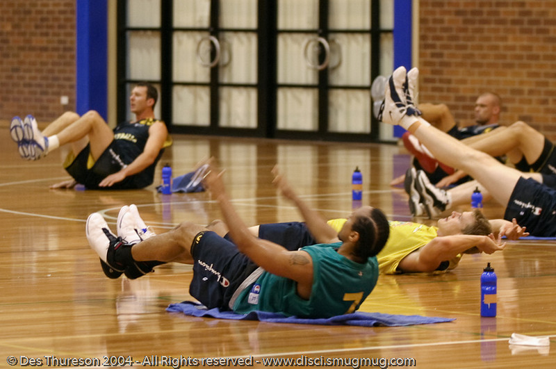 """""""Core Strength Time!"""" - Boomers' Basketball - Public Pre-Olympic  Training Session, 29 May 2004; Gold Coast, Queensland, Australia."""