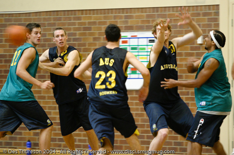 Point Guard CJ Bruton (R) gets away the no-look dump pass as Luke Schenscher arrives in help-defence - Boomers' Basketball - Public Pre-Olympic  Training Session, 29 May 2004; Gold Coast, Queensland, Australia.