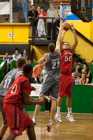 Omar Samhan shoots over Greg Vanderjagt - Gold Coast Blaze v St Mary's - Australian National Basketball League (NBL) pre-season game, 17 August, 2009.