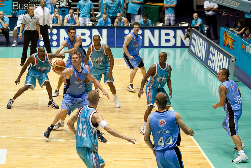 Tony Ronaldson is surrounded by a sea of blue as he catches the ball in the low post - Blaze v Breakers 31-12-2009
