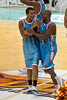 Tyson Demos and Ayinde Ubaka share a moment - Blaze v Breakers 31-12-2009