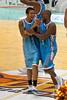 Tyson Demos and Ayinde Ubaka share a moment - Blaze v Breakers 31-12-2009