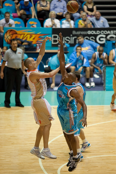 Taipan Phill Jones throws up the 'Hail Mary' shot in an attempt to beat the shot clock - Gold Coast Blaze v Cairns Taipans, 4 December 2009.