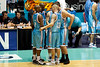 James Harvey conducts the 'starting 5 huddle' with Ayinde Ubaka, Erron Maxey, Adam Gibson & Anthony Petrie - Gold Coast Blaze v Cairns Taipans, 4 December 2009.