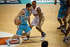 Adam Gibson tries to stay clear of Skip Mills - Gold Coast Blaze v Cairns Taipans, 4 December 2009.
