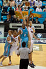Ian Crosswhite jumps against Erron Maxey - Gold Coast Blaze v Cairns Taipans, 4 December 2009.