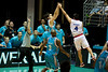 """""""Finger artwork"""" - Chris Goulding's team-mates wish the ball in as he shoots against Nathan Herbert - Blaze v 36ers 9-12-9"""