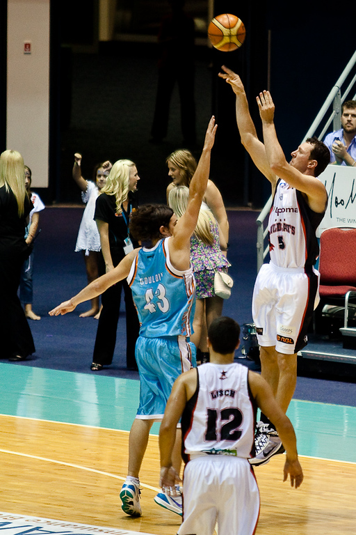 Wildcats veteran Martin Cattalini shoots over Chris Goulding - Gold Coast Blaze v Perth Wildcats NBL Basketball; 5 February 2010.