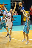 Gold Coast Blaze captain James Harvey just manages to shoot over the outstretched arm of 7 footer Luke Schenscher - Gold Coast Blaze v Perth Wildcats NBL Basketball; 5 February 2010.